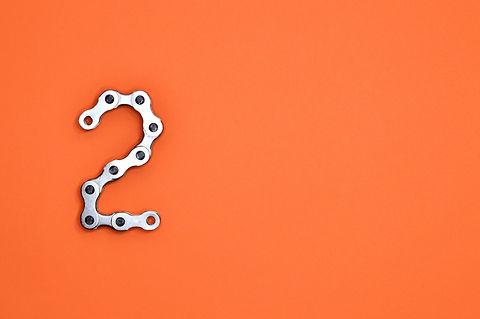 gray-steel-chain-on-orange-surface-10611