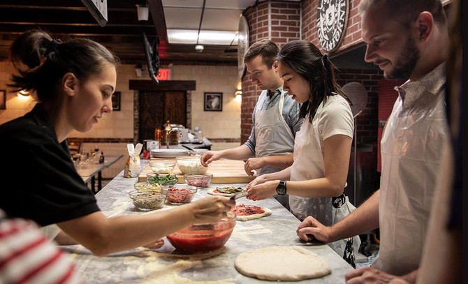 Learn How to Make Pizza While Drinking Bottomless Wine at This Cooking Class