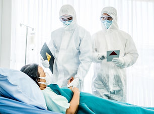 Doctors in the protective suits and mask