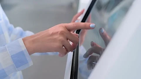 close-woman-using-touchscreen-display-fo