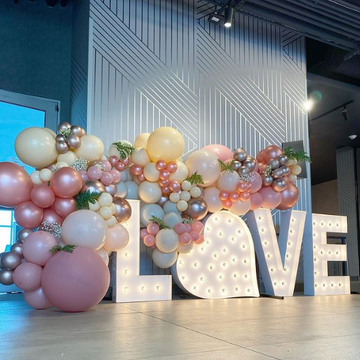 LOVE with heart and balloons, and greenery
