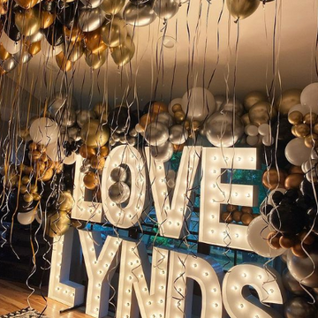 Stacked letters with balloons and helium balloons