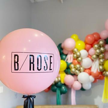 Jumbo helium balloon with tassel and custom vinyl decal