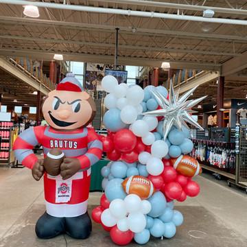 Freestanding balloon installation with football and start mylar balloons