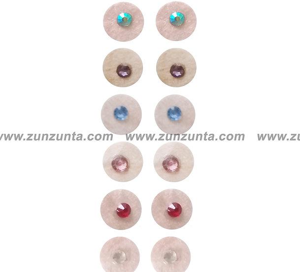 Parches color piel (Micropore) decorados con Swarovski 1000 pzs