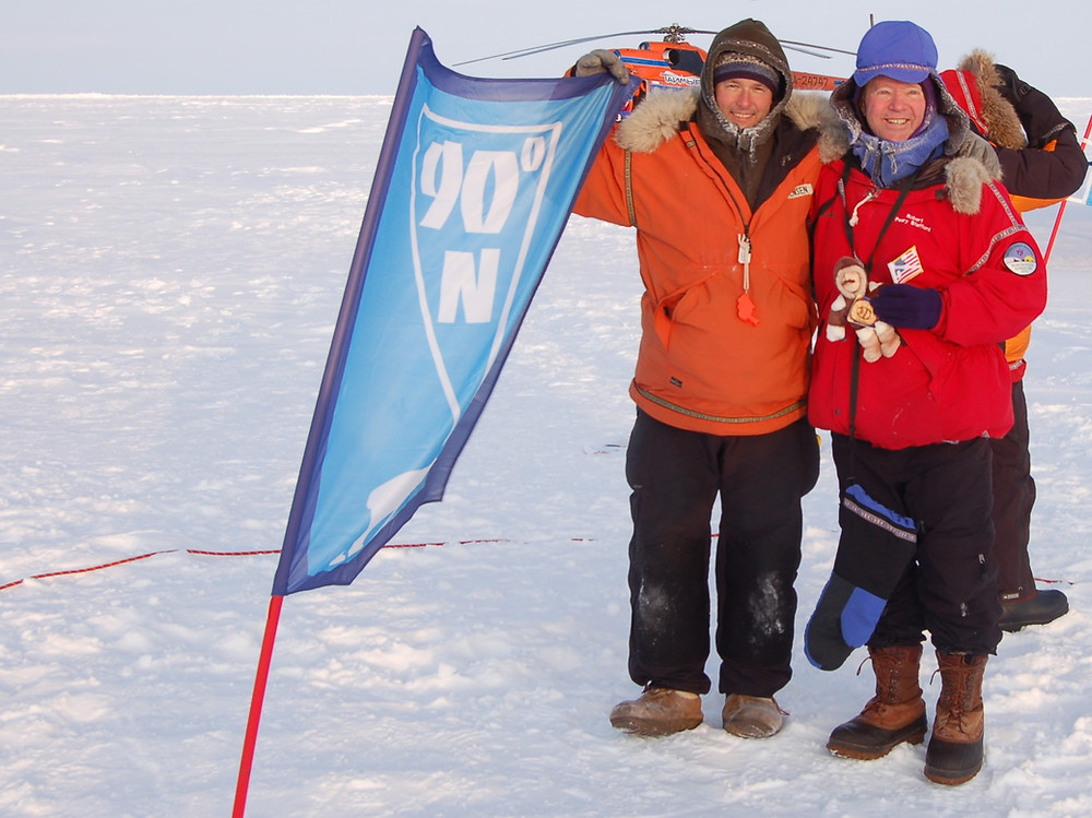 Standing at the North Pole.  The North Pole Flight is organized by PolarExplorers.