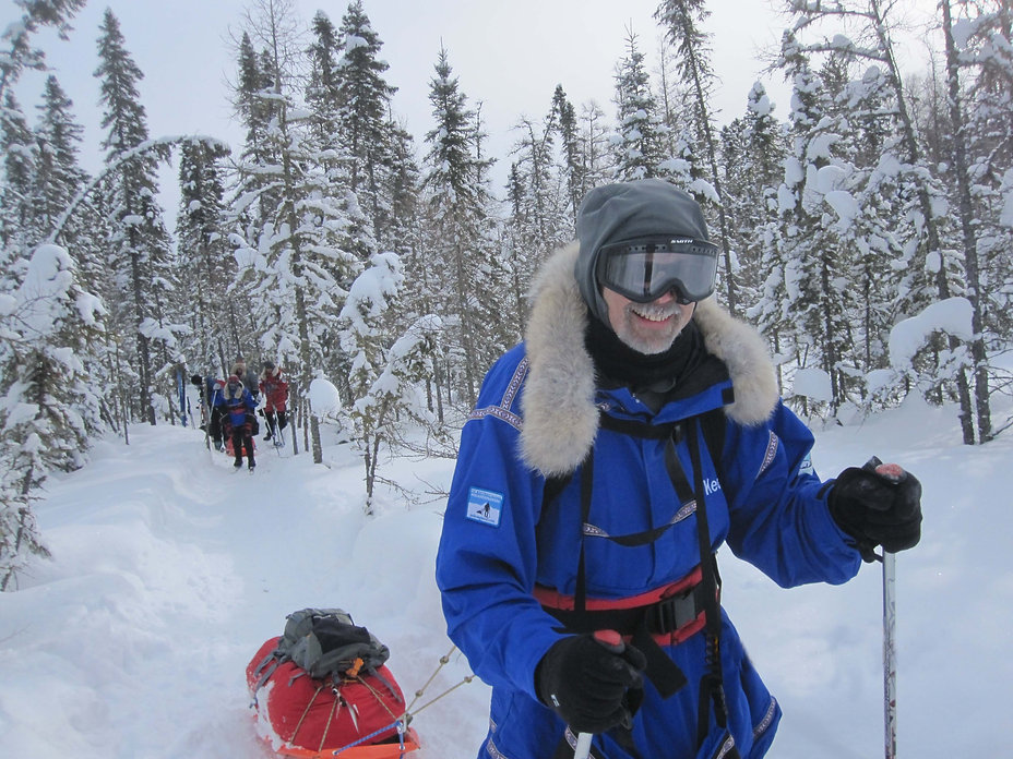 Skiers in the woods practicing their polar expedition skills during our Polar Training plus seminar.
