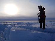 A skier navigates across the polar sea during a North Pole Last Degree Ski trek