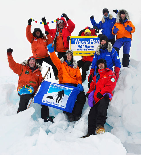 A group of last degree skiers celebrate at the North Pole after their North Pole ski trek from 89 degrees.