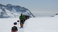 A team of skiers descends the Fortuna Glacier as the traverse the Shackleton Crossing of South Georgia Island.
