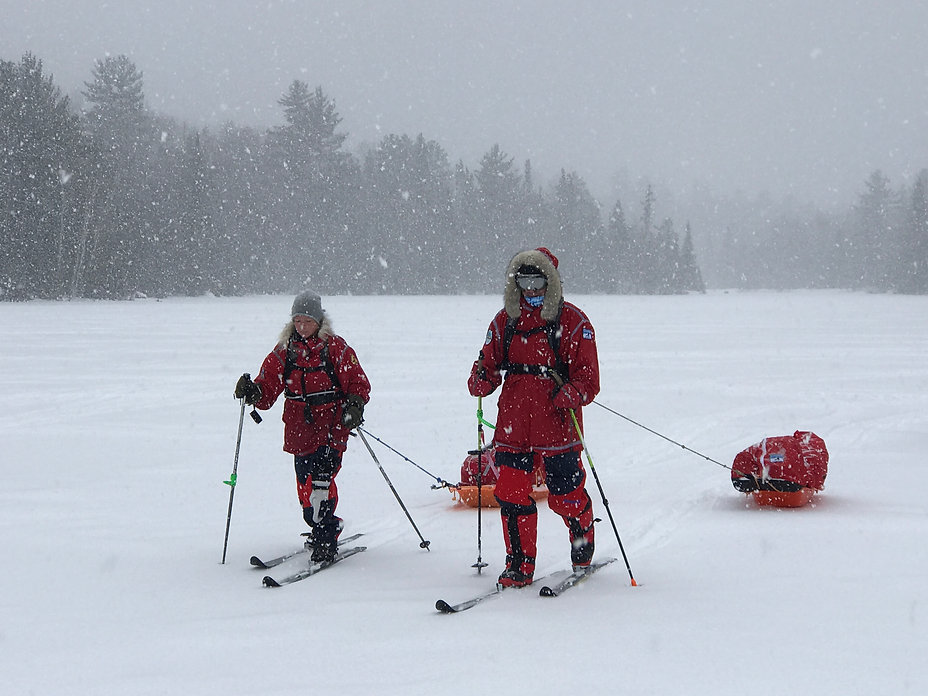 Two skiers pull sleds during our Polar Training, where they learn important expedition skills for their polar expeditions.