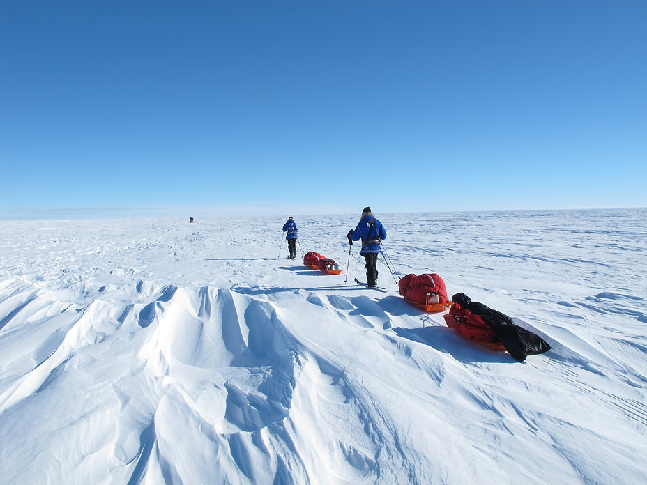 Skiers skiing across Antarctica on our full-distance South Pole Expedition