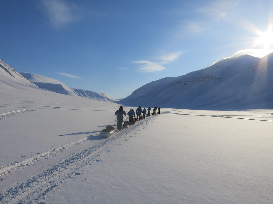 Skiers traversing a fjord in Spitsbergen during our Svalbard Ski Expedition