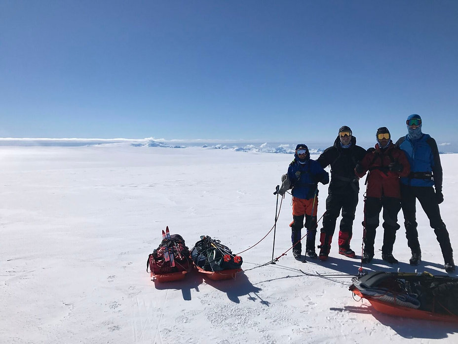 A team stands near the Grimsvotn volcano during our ski travers of the Vatnajokull glacier in Iceland