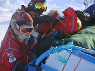 North Pole Dogsled expedition, the team pushes the dogsleds to try and get it off a block of ice.