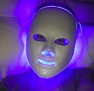 Kourtney-Kardashian-LED-Face-Mask.png