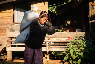 Woman carrying produce-Photo by  Robin B