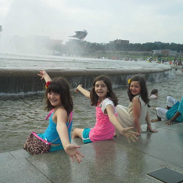 The girls kickin feet in the fountain