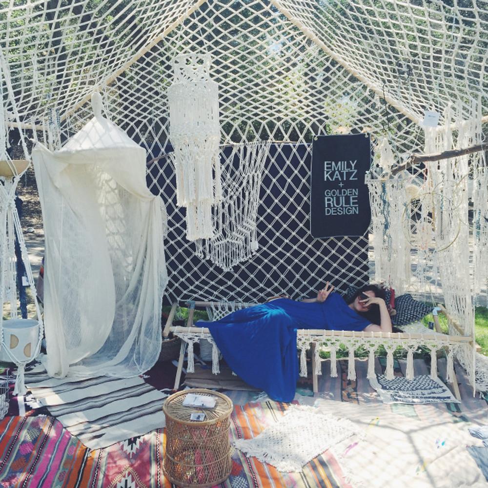 Brisa lounging in the Macrame tent