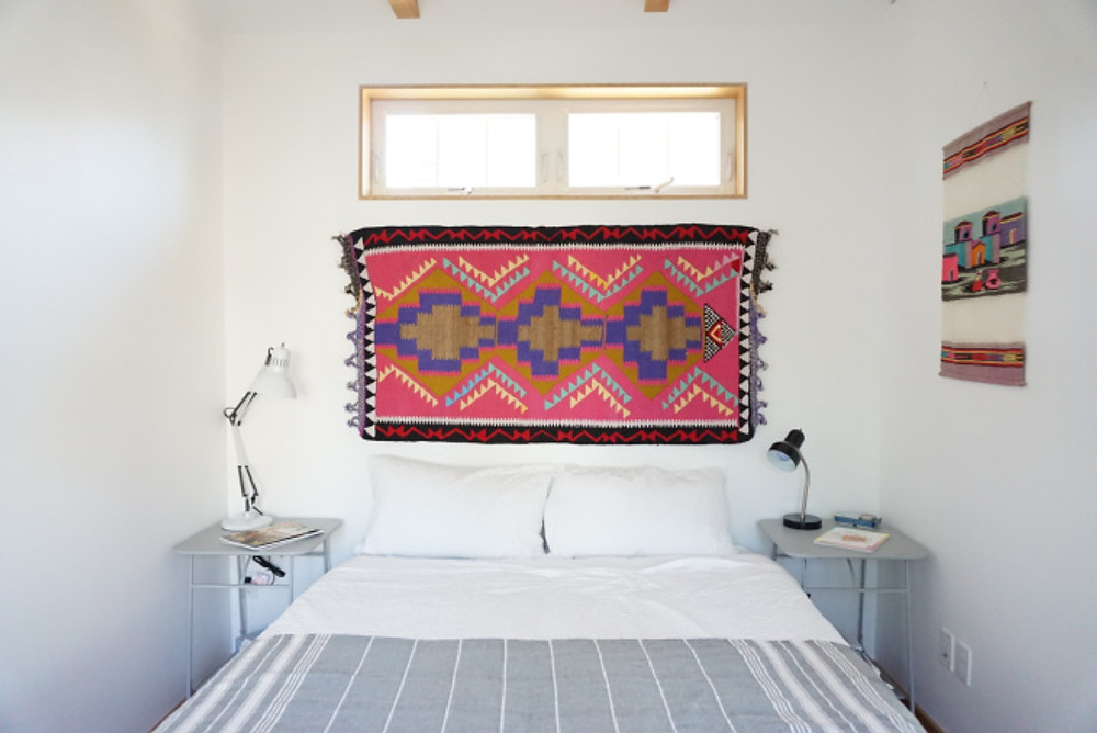 Patterned Rugs at A Headboard
