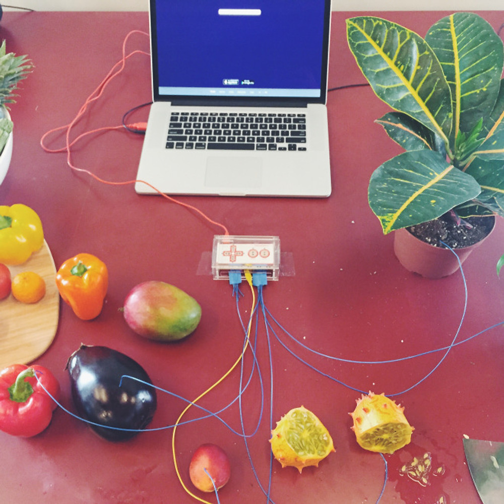 making music with fruit! playing with food is fun.