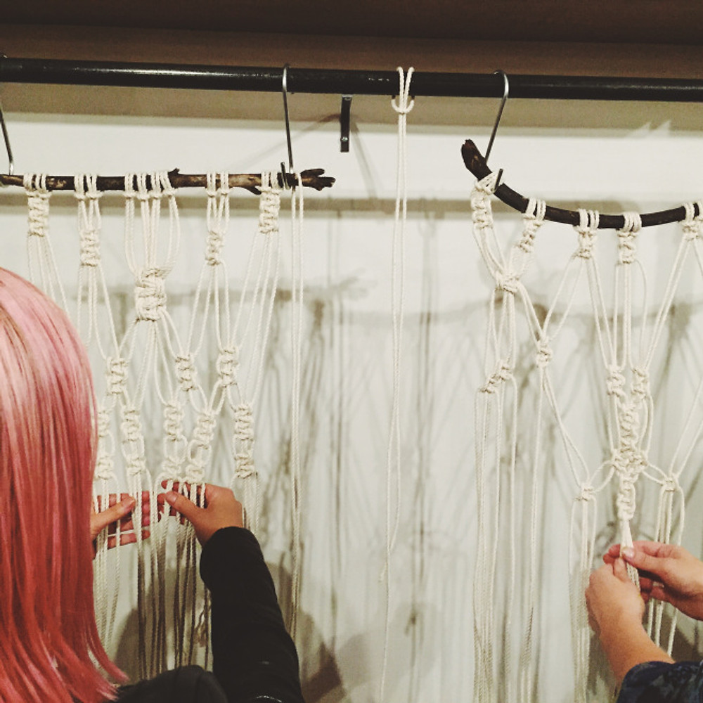 Pink hair really popping against her beautiful macrame