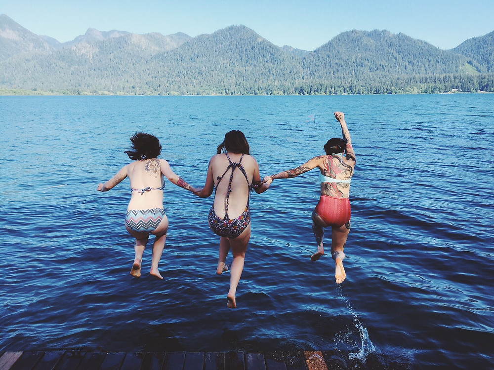 Freedom! jumping into lake quinalt-magicdreamlife