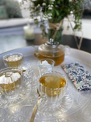 Tasse et soucoupe en verre strié