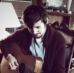 Gus. Singer/songwriter, guitar.