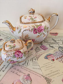 gold and floral tea pot and sugar cup