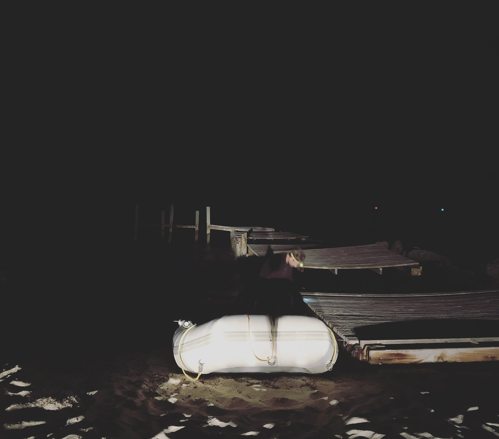 A  glimpse of our desolate dinghy and the messy dock