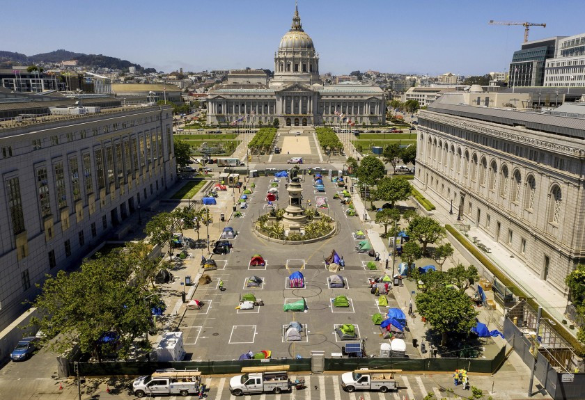 May 21, 2020, rectangles designed to help prevent the spread of the coronavirus by encouraging social distancing line a city-sanctioned homeless encampment at San Francisco's Civic Center. California has spent $13 billion in the last three years to tackle a massive homelessness problem likely to worsen with the pandemic, yet its approach is so disjointed and incomplete as to hinder efforts at getting people into stable housing, the state auditor said in a report released Thursday, Feb. 11, 2021. (AP Photo/Noah Berger, File) (ASSOCIATED PRESS)