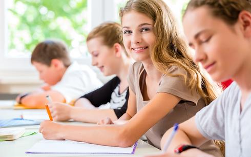 Homeschool female student taking notes i