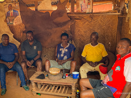 At the Obi, the Igbo People Sit Around the Elders