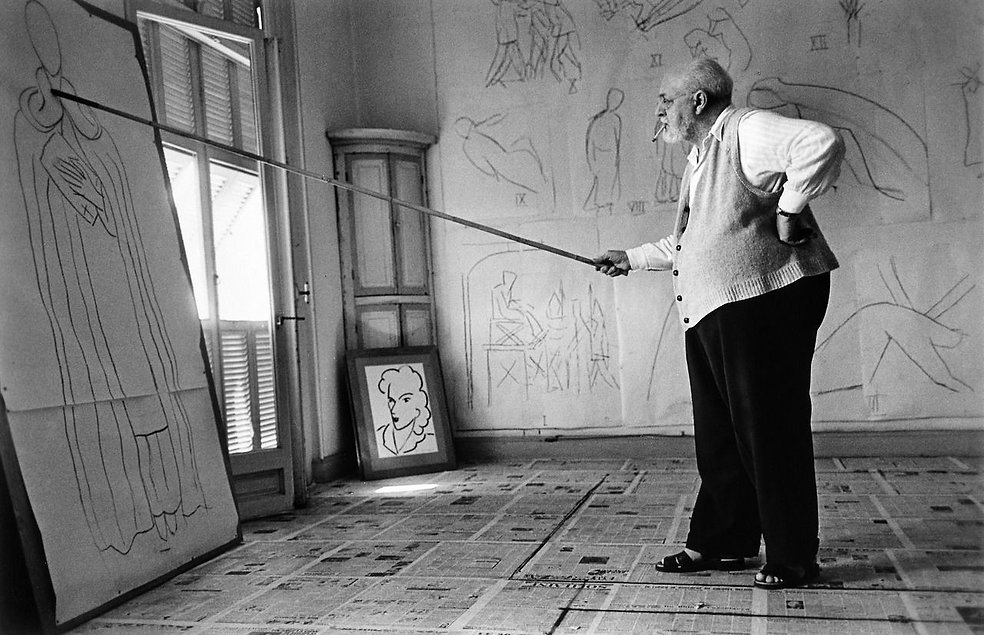 Robert Capa-Henri Matisse in his studio.