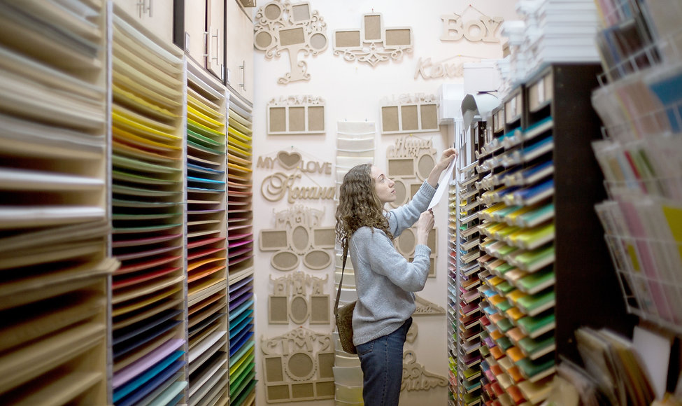 woman shopping in a arts and crafts store