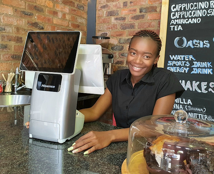 Hisense Luna HK718 with a lady on a counter in a coffee shop