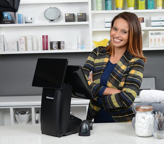 Hisense Lun HK718 on counter with lady in a salon