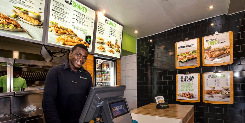 posters and menu boards in a fast food restaurant