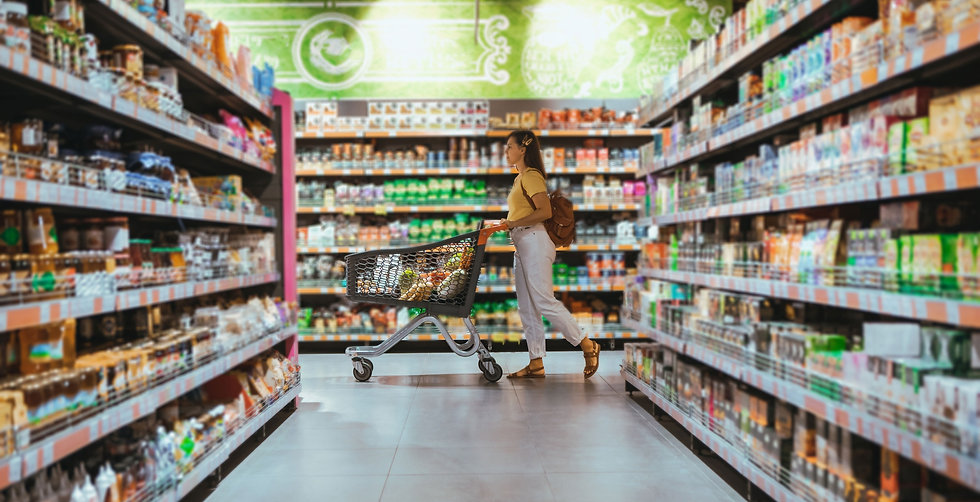 woman walking with a trolley in a food supermarket