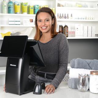 Sales assistant with Hisense Luna on cou
