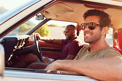 Two Male Friends Relaxing In Car During