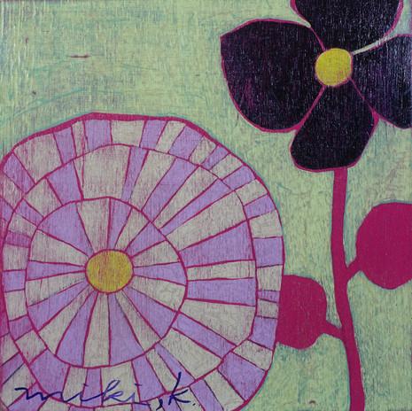 上にのびる花
