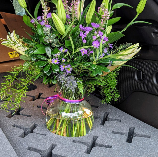 Lillies and purple aster bouquet