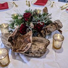 Driftwood sculpture and bouquet