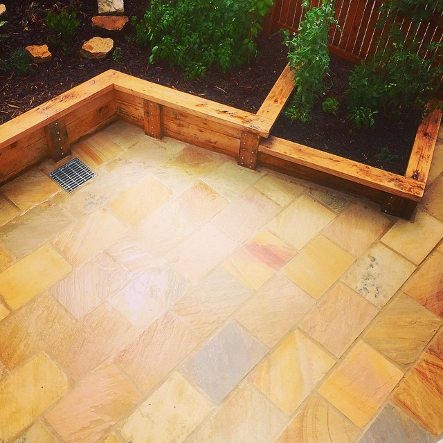 Himalayan sandstone and hardwood garden beds