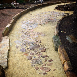 Exposing 200 year old cobble stone flagging that was buried under 20cm of soil, old bottles and rand