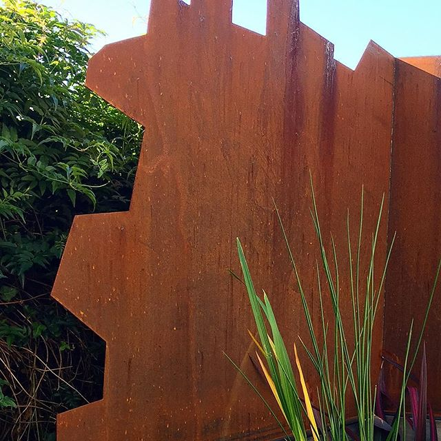 Corten steel feature at our Adelaide st project #vandiemenslandscapes #corten #landscaping #gardenst