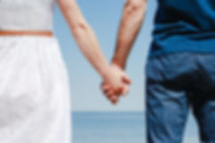 Close up of loving couple holding hands