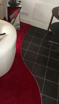 Black Onyx tile flooring & bespoke curved edging (1).JPG